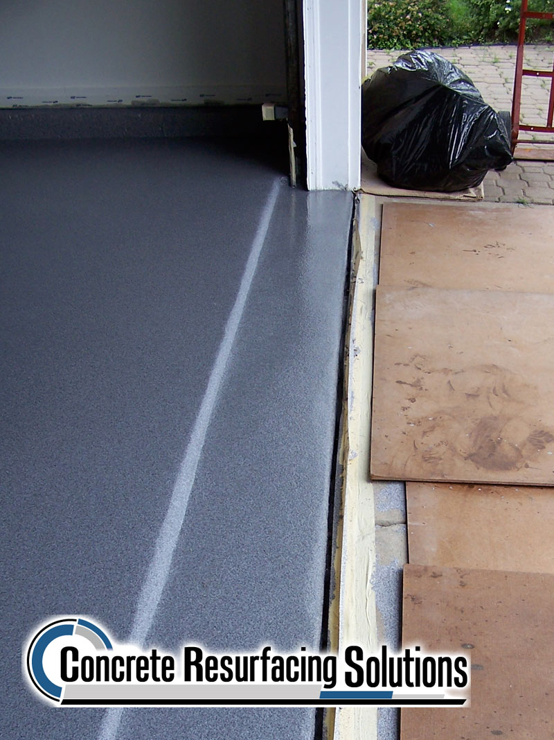 A residential garage looks amazing after Concrete Resurfacing Solutions Chicago refinishes it!